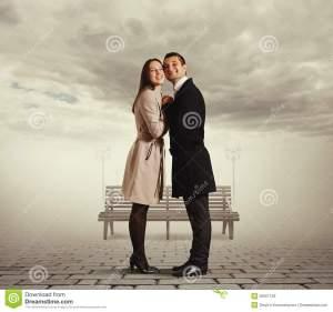 smiley-couple-flirting-embracing-outdoor-35907129